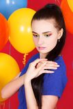 Young attractive woman among bright balloons Royalty Free Stock Photography