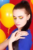 Young attractive woman among bright balloons Royalty Free Stock Image