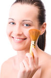 Young attractive woman with brush Royalty Free Stock Photography