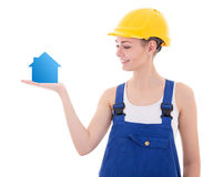 Young attractive woman builder holding small house in hand isola Royalty Free Stock Photography