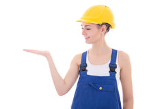 Young attractive woman builder holding something in hand isolate Royalty Free Stock Image