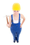 Young attractive woman builder in workwear with hammer isolated Stock Photos