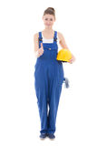 Young attractive woman builder in workwear thumbs up isolated on Royalty Free Stock Photos