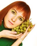 Young attractive woman with bunch of grap Royalty Free Stock Photo