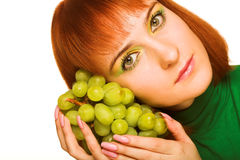 Young attractive woman with bunch of grap Royalty Free Stock Photos