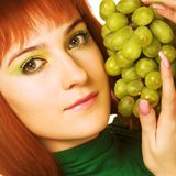 young attractive woman with bunch of grap Stock Image