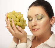 Young attractive woman with bunch of grapes Royalty Free Stock Images