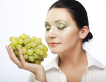 Young attractive woman with bunch of grapes Stock Photos
