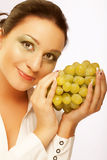 Young attractive woman with bunch of grapes Royalty Free Stock Photography
