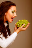 Young attractive woman with bunch of grapes Royalty Free Stock Image