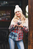 Young attractive woman in the cafe with old camera Stock Photography