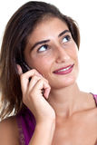 Young attractive woman on the cell phone. Beautiful female having call, listening, smiling and looking upwards, closed up. Portrait, isolated on white Royalty Free Stock Photography