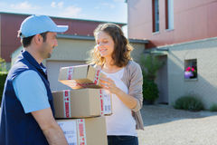 Young attractive woman checking her parcel Royalty Free Stock Photo