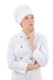 Young attractive woman chef dreaming isolated on white Stock Photos