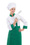 Young attractive woman chef with mixer isolated on white Stock Photo
