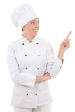 Young attractive woman chef showing or presenting something isol Royalty Free Stock Photos