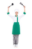 Young attractive woman in chef uniform with kitchen tools - full Stock Photo
