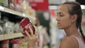 Young attractive woman choosing instant food at the supermarket stock video