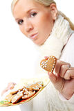 Young attractive woman with christmas cookies. Stock Photos