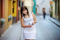 Young attractive woman in a city Royalty Free Stock Image