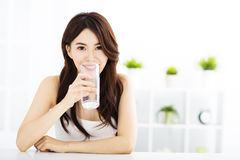 Young attractive woman with clean water Royalty Free Stock Photo