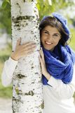 Young attractive woman close to a birch tree Stock Photo