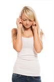 Young attractive woman closes ears Royalty Free Stock Photo