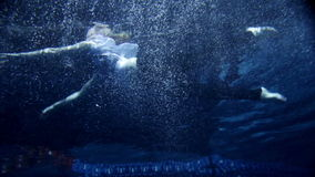 Young attractive woman in clothes swimming under water. Underwater activity and young woman in clothes swimming under water stock footage