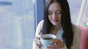 A young attractive woman with a coffee stock footage