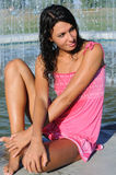 Young attractive woman cooling near the fountain Royalty Free Stock Image