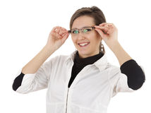 Young attractive woman correcting glasses Stock Images