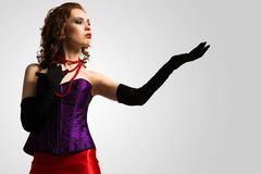 Young attractive woman in corset and red dress Royalty Free Stock Photo