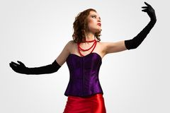 Young attractive woman in corset and red dress Royalty Free Stock Photography