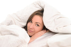 Young attractive woman covered with blanket Stock Photo