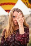 Young attractive woman covering eye with mehendi hand royalty free stock photography