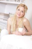 Young attractive woman with cup Royalty Free Stock Photography