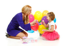 Young attractive woman with cute little girl play mother-daughte Royalty Free Stock Image