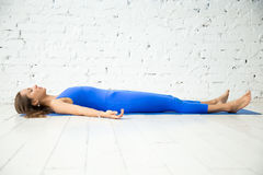 Young attractive woman in Dead body pose, white studio backgroun Stock Images