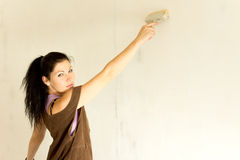 Young attractive woman decorating Stock Image