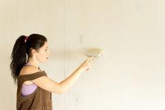 Young attractive woman decorating walls royalty free stock images