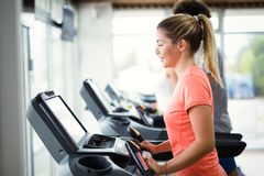 Young attractive woman doing cardio training in gym Royalty Free Stock Image