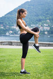 Young attractive woman doing exercises outdoors Royalty Free Stock Images
