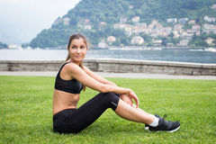 Young attractive woman doing exercises outdoors Stock Photo