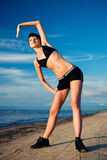 Young attractive woman doing fitness exercise Stock Photography