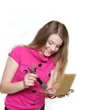 Young attractive woman doing make up Stock Photo