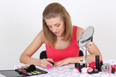 Young attractive woman doing manicure Royalty Free Stock Images