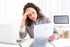 Young attractive woman doing paperwork Royalty Free Stock Photo