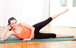 Young attractive woman doing pilates Stock Image