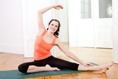 Young attractive woman doing pilates Stock Photography