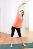 Young attractive woman doing pilates Royalty Free Stock Photo
